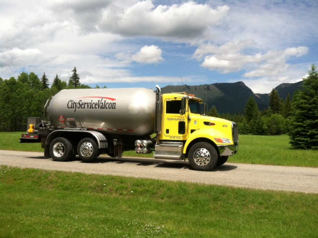 Propane supplier Bobtail truck making a propane delivery for propane tanks